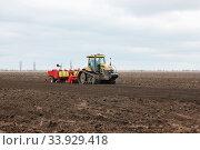 Modern tractor on soil treated cultivator in the field. Стоковое фото, фотограф Nataliia Zhekova / Фотобанк Лори