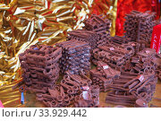 Купить «reproduction in milk chocolate, screws and bolts. chocolate candies in the form of old rusty metal locksmith tools», фото № 33929442, снято 25 ноября 2018 г. (c) Nataliia Zhekova / Фотобанк Лори