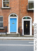 The blue and black doors in Dublin, Ireland. Arched Georgian door house front (2019 год). Стоковое фото, фотограф Nataliia Zhekova / Фотобанк Лори