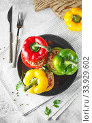 Colorful stuffed peppers with rice and minced meat. Stuffed paprika with rice and chopped meat. Стоковое фото, фотограф Nataliia Zhekova / Фотобанк Лори
