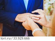 Купить «Engagement ring on the finger of the groom», фото № 33929666, снято 14 августа 2015 г. (c) Nataliia Zhekova / Фотобанк Лори