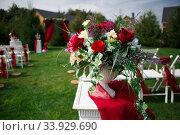 Купить «Wedding decorations marriage decor rustic style bridal arch and flowers,», фото № 33929690, снято 12 сентября 2015 г. (c) Nataliia Zhekova / Фотобанк Лори