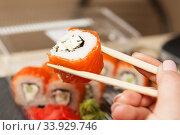 Sushi roll philadelphia. Business lunch concept. Стоковое фото, фотограф Nataliia Zhekova / Фотобанк Лори