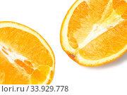 Купить «Two half juicy ripe orange isolated on white background», фото № 33929778, снято 26 января 2019 г. (c) Nataliia Zhekova / Фотобанк Лори