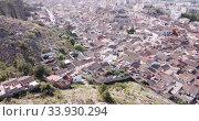 Купить «Aerial panoramic view of Xativa cityscape with Collegiate Basilica of Santa Maria, Spain», видеоролик № 33930294, снято 16 апреля 2019 г. (c) Яков Филимонов / Фотобанк Лори