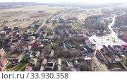 Купить «Flight over the village Wlodowice. Poland», видеоролик № 33930358, снято 13 марта 2020 г. (c) Яков Филимонов / Фотобанк Лори