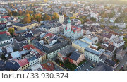 Купить «Aerial view of Sumperk cityscape overlooking Town hall and Saint John Baptist church on autumn day, Czech Republic», видеоролик № 33930374, снято 17 октября 2019 г. (c) Яков Филимонов / Фотобанк Лори