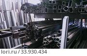 Small warehouse of metal beams components of industrial manufacture. Стоковое видео, видеограф Яков Филимонов / Фотобанк Лори