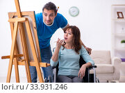 Disabled wife and young husband at home. Стоковое фото, фотограф Elnur / Фотобанк Лори