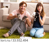 Young family with kitten playing at home. Стоковое фото, фотограф Elnur / Фотобанк Лори