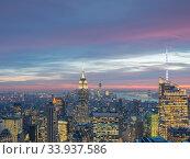 Купить «Night view of New York Manhattan during sunset», фото № 33937586, снято 20 декабря 2013 г. (c) Elnur / Фотобанк Лори