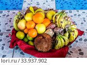 Купить «Colorful fresh fruits mixed in the basket lay on the tiling», фото № 33937902, снято 4 августа 2020 г. (c) easy Fotostock / Фотобанк Лори
