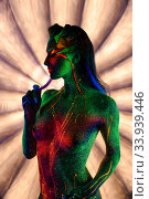 Girl with ultraviolet shimmer bodyart profile shot. Стоковое фото, фотограф Гурьянов Андрей / Фотобанк Лори