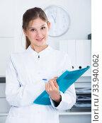 Female doctor writing notes in clinic. Стоковое фото, фотограф Яков Филимонов / Фотобанк Лори