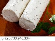 Купить «Soft goat cheese with herbs and garlic», фото № 33940334, снято 30 июня 2020 г. (c) Яков Филимонов / Фотобанк Лори