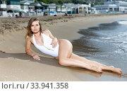 Купить «Young sexy girl in swimsuit and hat relaxation at sandy beach», фото № 33941358, снято 10 июля 2018 г. (c) Яков Филимонов / Фотобанк Лори