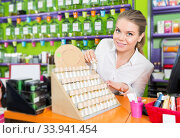 saleswoman offering new fragrance. Стоковое фото, фотограф Яков Филимонов / Фотобанк Лори