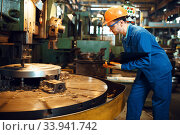 Turner stanging at the automated lathe, factory. Стоковое фото, фотограф Tryapitsyn Sergiy / Фотобанк Лори