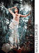 Купить «Gorgeous young woman wearing long evening fashionable dress posing in forest. Beauty and fashion concept», фото № 33941918, снято 7 сентября 2014 г. (c) Alexander Tihonovs / Фотобанк Лори