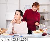 Mature female talking with young sad daughter. Стоковое фото, фотограф Яков Филимонов / Фотобанк Лори