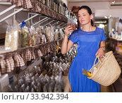 Купить «Customer choosing candied fruits», фото № 33942394, снято 13 июня 2017 г. (c) Яков Филимонов / Фотобанк Лори