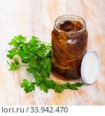Jar with canned mushrooms and fresh parsley. Стоковое фото, фотограф Яков Филимонов / Фотобанк Лори