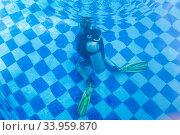 Купить «Learning to Scuba Dive in a Swimming Pool», фото № 33959870, снято 1 марта 2019 г. (c) Matej Kastelic / Фотобанк Лори