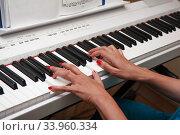 Hands of a young woman playing the piano. Стоковое фото, фотограф Nataliia Zhekova / Фотобанк Лори