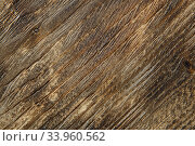 Wooden background texture. Brown scratched wooden cutting board. Стоковое фото, фотограф Nataliia Zhekova / Фотобанк Лори