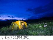Купить «Tent in the field at night, camping concept travel», фото № 33961202, снято 7 июня 2018 г. (c) Константин Лабунский / Фотобанк Лори