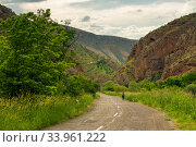 Highway in a picturesque gorge with red mountains near Noravank Monastery, Armenia. Стоковое фото, фотограф Константин Лабунский / Фотобанк Лори