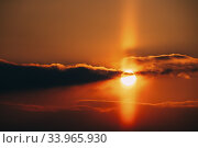 Купить «Natural Sunny Light Pillar During Winter Sunset. Atmospheric Optical Phenomenon In Form Of A Vertical Band Of Light Which Appears To Extend Above And Or Below A Light Source.», фото № 33965930, снято 26 февраля 2018 г. (c) easy Fotostock / Фотобанк Лори