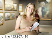 Woman with glasses visiting museum of arts. Стоковое фото, фотограф Яков Филимонов / Фотобанк Лори
