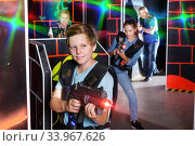 Teenager boy with laser gun on lasertag arena. Стоковое фото, фотограф Яков Филимонов / Фотобанк Лори