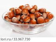 Unpeeled hazelnut in glass cup. Стоковое фото, фотограф Яков Филимонов / Фотобанк Лори