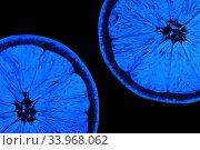 Купить «Two half juicy ripe orange isolated on white background», фото № 33968062, снято 26 января 2019 г. (c) Nataliia Zhekova / Фотобанк Лори