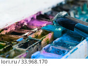 artists brushes and watercolour paints on palette. Стоковое фото, фотограф Nataliia Zhekova / Фотобанк Лори