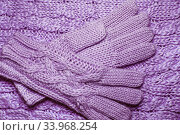 Купить «Wool sweater or scarf and gloves texture close up.», фото № 33968254, снято 27 ноября 2015 г. (c) Nataliia Zhekova / Фотобанк Лори