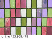 texture of old wall tiles with peeling bright paint. colorful old shabby tiles. Стоковое фото, фотограф Nataliia Zhekova / Фотобанк Лори
