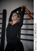 Купить «Modern gym - a young woman doing exercise near the wall», фото № 33969614, снято 3 марта 2020 г. (c) Константин Шишкин / Фотобанк Лори