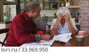 Купить «Senior African American husband and mixed race wife working together at home», видеоролик № 33969950, снято 19 февраля 2020 г. (c) Wavebreak Media / Фотобанк Лори