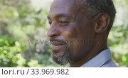 Купить «Senior Afrian American man smiling and looking at the camera», видеоролик № 33969982, снято 19 февраля 2020 г. (c) Wavebreak Media / Фотобанк Лори