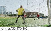 Купить «African American kid in red scoring in a sunny day», видеоролик № 33970102, снято 18 октября 2019 г. (c) Wavebreak Media / Фотобанк Лори