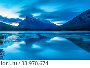 Купить «Mount Rundle at dawn, near city of Banff, Banff National Park,Alberta,Canada, UNESCO, World Heritage Site,», фото № 33970674, снято 10 июля 2020 г. (c) age Fotostock / Фотобанк Лори