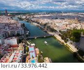 Aerial view Sevilla of city center with embankment of Guadalquivir. Spain (2019 год). Стоковое фото, фотограф Яков Филимонов / Фотобанк Лори