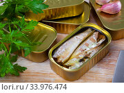 Купить «Natural mackerel fillets in open tin can and fresh parsley on wooden table», фото № 33976474, снято 4 августа 2020 г. (c) Яков Филимонов / Фотобанк Лори
