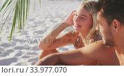 Купить «Caucasian couple enjoying time at the beach», видеоролик № 33977070, снято 25 февраля 2020 г. (c) Wavebreak Media / Фотобанк Лори