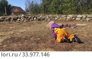 Купить «Caucasian toddler boy crawling on meadow in house backyard, wearing yellow trousers from waterproof and dirt-resistant material», видеоролик № 33977146, снято 18 мая 2020 г. (c) Кекяляйнен Андрей / Фотобанк Лори