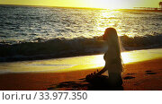 Купить «Kundalini yoga by sea and woman meditation in lotus position», видеоролик № 33977350, снято 25 сентября 2019 г. (c) Gennadiy Poznyakov / Фотобанк Лори