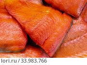 Купить «Close up view of piece cold smoked salted Pacific red fish Chinook Salmon. Prepared, ready-to-eat Pacific seafood. King Salmon Asian delicacy cuisine», фото № 33983766, снято 11 июня 2020 г. (c) А. А. Пирагис / Фотобанк Лори